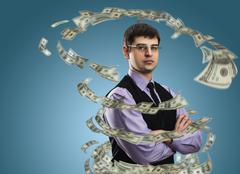 Businessman with money vortex Stock Photos