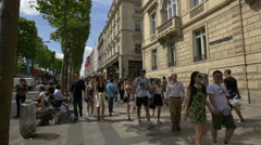 Walking on Av. des Champs-Elysees, cross to Rue Balzac, in Paris Stock Footage