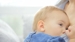 Closeup of woman breast feeding baby girl Stock Footage