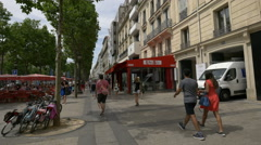 Walking by Le Madrigal restaurant on Avenue des Champs-Elysees in Paris Stock Footage