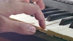 Stock Video Footage of playing man hand synthesizer piano run over keys