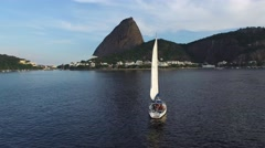 Sailboat Travel on Guanabara Bay with Sugarloaf Mountain Stock Footage