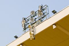 White loudspeakers and spotlight on the metal construction - stock photo