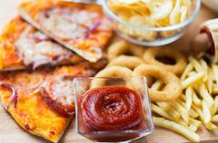 Close up of fast food snacks on wooden table Kuvituskuvat