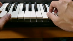 Stock Video Footage of playing man hand synthesizer music piano run over keys