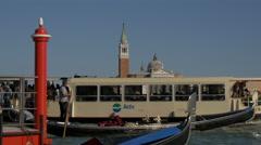 Sightseeing boat and gondola close to Chiesa San Giorgio Maggiore, Venice Stock Footage