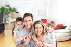 Happy family in a new house. - stock photo