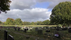 cemetry graveyard moody sky moving clouds trees rural - stock footage