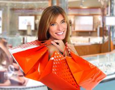 Shopping woman with paper bags. Stock Photos