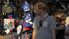 Venezia hats hanging on a souvenir stall in Venice Stock Footage
