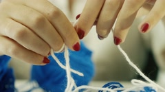 Closeup view of women hands playing with woolen thread Stock Footage