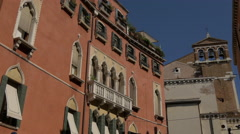 View of a building with arches and a church belfry with three bells in Venice Stock Footage