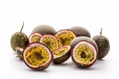 Flesh Of Halved Passionfruits In Their Hard Rind Stock Photos