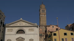 The Leaning Tower Santo Stefano and San Maurizio Church in Venice Stock Footage