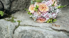 Wedding rings and wedding bouquet Stock Footage