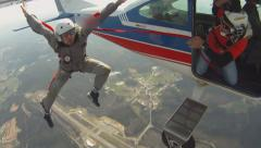 Skydivers exit from the plane Stock Footage