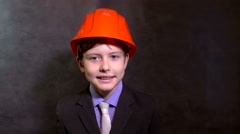 Teen portrait boy builder in helmet smiling Stock Footage