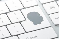 Advertising concept: Head on computer keyboard background Stock Illustration