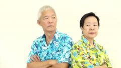 Asian senior couple fighting, pouting and upset to each other on holiday trip - stock footage