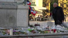 Flowers, candles, notes in tribute to victims terrorist attacks 13/11 in Paris 5 Stock Footage