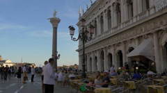 Relaxing at an outdoor restaurant in Piazza San Marco, Venice Stock Footage