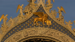 Lion with wings and angels statues on Basilica di San Marco, Venice Stock Footage