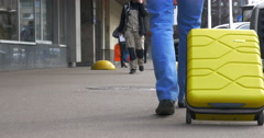 Man With A Suitcase On Wheels In The City Street Stock Footage