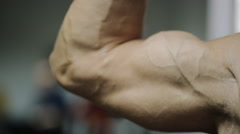 Movement of muscles in the arms, on the hand of an adult male athlete, hands Stock Footage