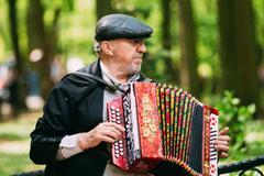 Street Busker performing songs in city park in Gomel, Belarus Stock Photos