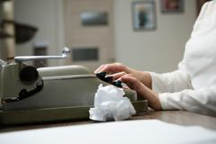 Typewriter with crumpled paper Stock Photos