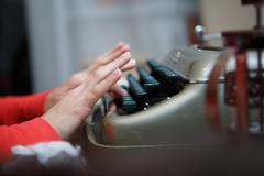 Hands of a man typing on typewriter - stock photo