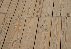 Stock Photo of Vintage wooden surface with planks and gaps in perspective