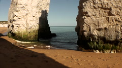 Camera pans up white chalk stack and Cliffs, Botany Bay, Kent, UK Stock Footage