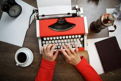 Vintage red typewriter with blank paper Stock Photos
