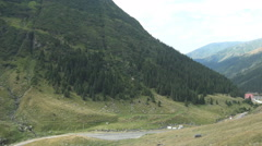 Alpine Landscape Road Crossing Mountain Range Spectacular Relief Wild Nature   Stock Footage