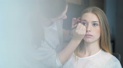 Model getting professional makeup - stock footage