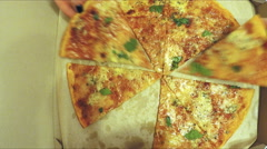 Hands taking pizza cuts - stop motion animation Stock Footage