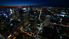 Time Lapse of Twilight City Lights shot on Rooftop in Downtown LA -Tilt Down- Stock Footage
