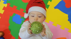Happy baby wearing Santa Clause hat smiling - stock footage