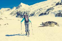 Ski touring in sunny weather. Stock Photos