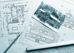 Architectural project of wooden mansion - stock photo