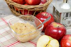 applesauce with some apples - stock photo