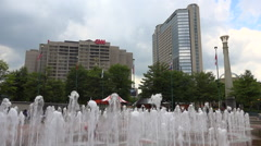 Kids play in the fountains at Centennial Olympic Park in Atlanta, Georgia with Stock Footage