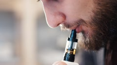 Man Exhaling smoke from a vaporizer 120 FPS three - stock footage