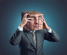 Businessman with rubik cube head Stock Photos