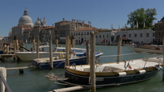 Boats moored close to Basilica di Santa Maria della Salute, Venice Stock Footage