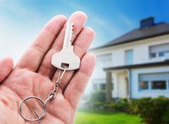 Key in hand - stock photo