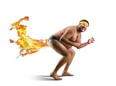 Naked freak farts by fire - stock photo