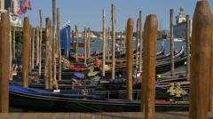 Gondolas moored close to Punta della Dogana di Mare in Venice Stock Footage