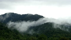 mist misty fog forest time lapse clouds moving over mountains asia vietnam 4k - stock footage
